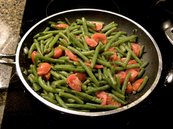 Combine green beans and tomatoes