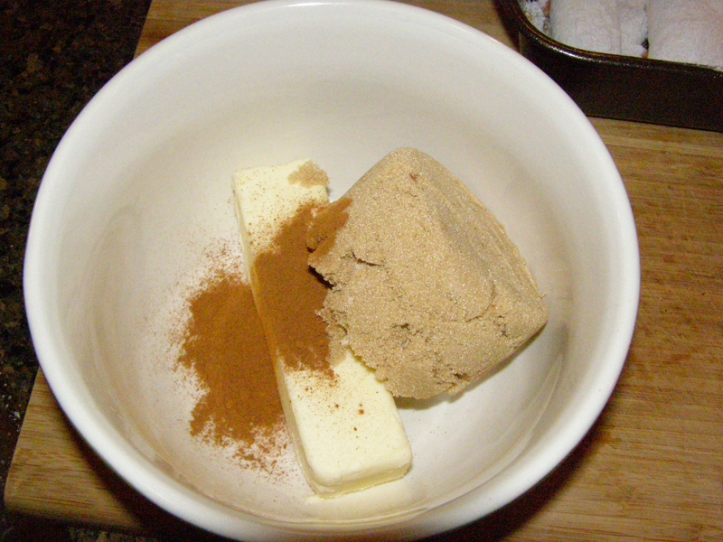 Butter, brown sugar, and cinnamon in a bowl ready to be melted