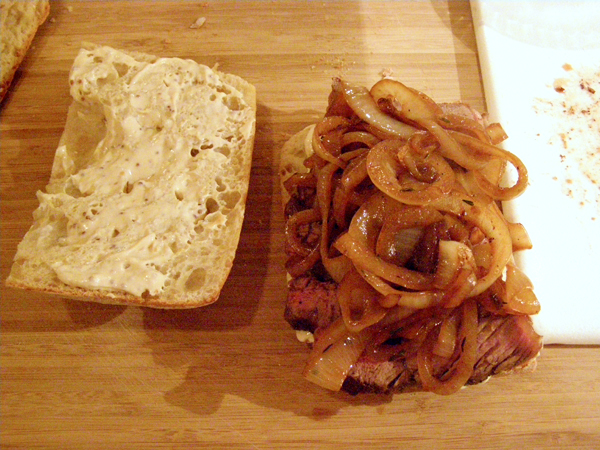 Top Steak Sandwich with Grilled Onions with caramelized onions