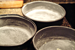 Grease and flour cake pans